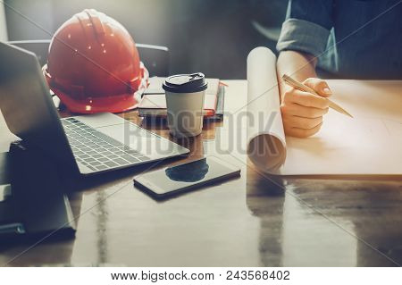Architect Design Concept, Engineering Hand Holding Pencil Design Building On Blueprint Of Drawing In