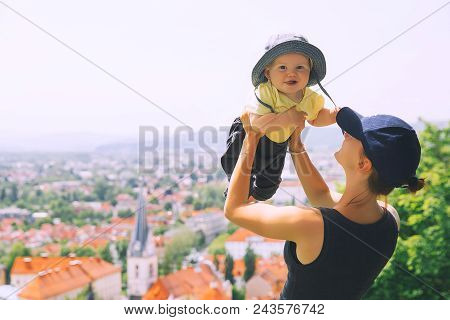 Woman And Child On Background Of Panoramic View With Red Roofs Of Ljubljana City. Springtime Or Summ