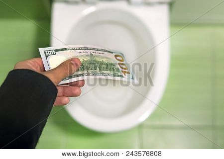 Flush Money Down The Toilet, Throws Dollar Bills In The Toilet, Loss Concept, Close Up, Selective Fo
