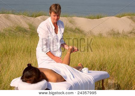 Massage in the dunes on the island Ameland, the Netherlands poster