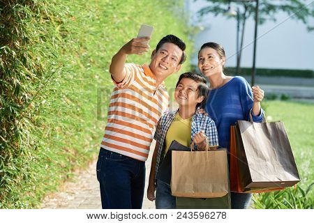 Handsome Middle-aged Man Taking Selfie With His Pretty Wife And Little Son After Successful Completi