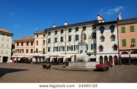 Piazza Paolo Diacono in the UNESCO World Heritage Centre town of Cividale Del Friuli Italy. The statue atop the fountain features four lion heads and Diana The Hunter and was donated to the city by Earl de Claricini of Bottenicco poster