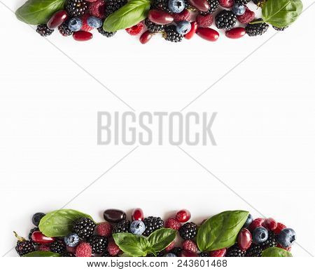 Black-blue And Red Berries Isolated On White. Ripe Blackberries, Blueberries, Raspberries, Cornels A