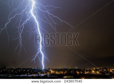 Lightning Bolt Striking City Skyline