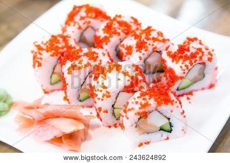 Asian Menu. Californian Sushi Rolls With Masago Caviar Near Ginger And Wasabi On White Plate. Japane