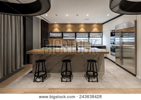 Kitchen In A Modern Style With Light Walls And A Parquet And Tiles On A Floor. There Are Lockers, Sh