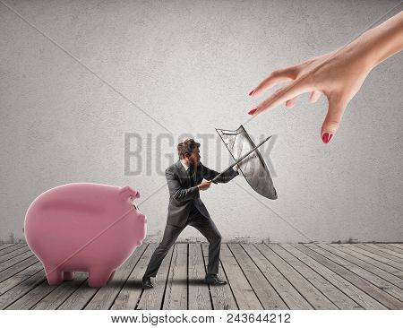 Business Man Protects A Piggy Bank Fighting Against A Hand Trying To Steal The Money. 3d Rendering
