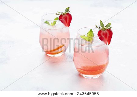 Iced Tea With Strawberries And Mint. On A White Background.