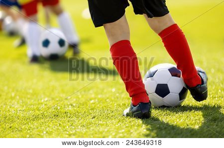 Kids Junior Football Training Session. Soccer Training For Children. Close Up Of Child Soccer Player