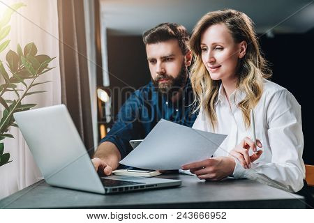 Business Meeting. Teamwork. Businesswoman And Businessman Sitting At Table In Front Of Laptop, Worki