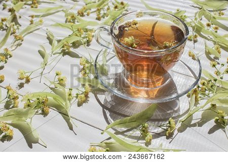 Tea. Green Tea. Herbal Tea. Mint Leaf. Tea With Apple Flavor. Tea In A Glass Cup With Apple Blossoms