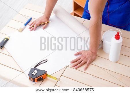 Worker working on wallpaper during refurbishment poster