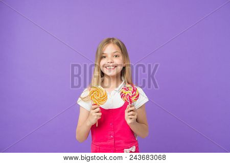 Diet And Dieting. Girl Smile With Lollipops On Violet Background. Happy Kid With Caramels. Small Chi