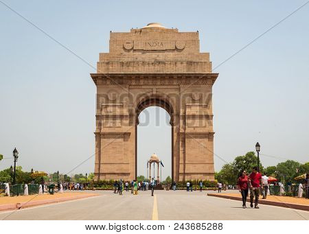 NEW DELHI, INDIA - CIRCA APRIL 2017: Tourists visiting India Gate. India Gate is a war memorial for soldiers who died during the First World War.