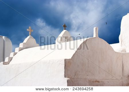 Church Dome And Crosses In Mykonos, Greece. Chapel Building Detail Architecture. White Church On Clo