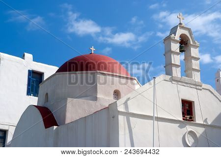 Church With Bell Tower And Red Dome In Mykonos, Greece. Chapel Building Architecture. White Church O