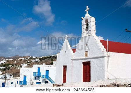 Church With Bell Tower Church Building Architecture On Blue Sky. Houses On Mountain Landscape. Summe