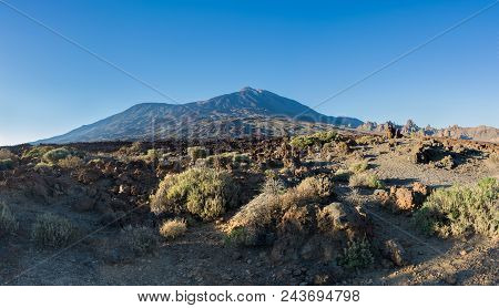 Majestic Panoramic View Of Teide Volcano And Roques De Garcia At Sunset. Tenerife, Canary Islands.