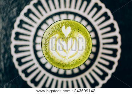Trendy Green Latte. Avocado Or Matcha Taste With Latte Art.
