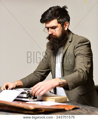 Bearded Man Type On Typewriter. Man With Long Beard And Mustache Typewrite Research Paper. Businessm