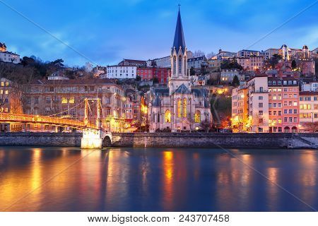 Panoramic View Of Saint Georges Church And Footbridge Across Saone River In The Old Town During Even