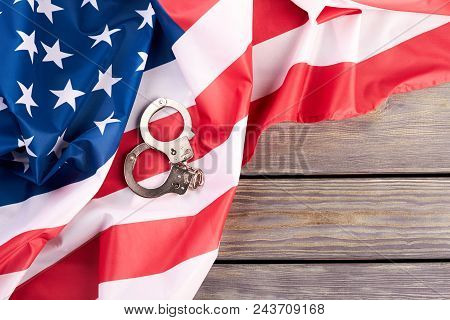 Usa Flag And Handcuffs, Top View. Usa Flag With Steel Handcuffs And Copy Space. Usa Legal System Con