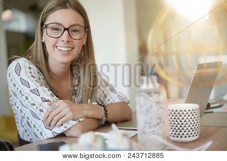 Cheerful trendy girl in co-working office