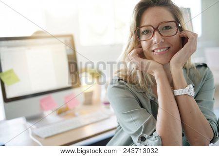 Beautiful woman working on desktop computer, co-working area