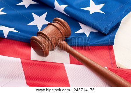 Close Up Wooden Gavel And American Flag. Judge Gavel And Flag Of United States Of America. Law And J