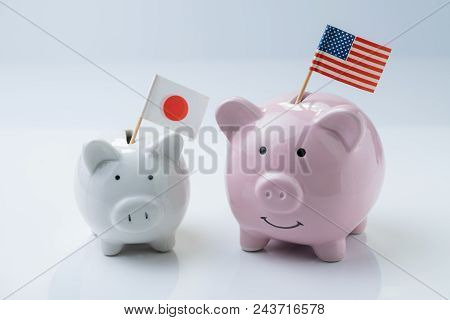 America And Japan Friendship, Talk, Negotiation, Economic And Diplomacy Concept, Pink Piggy Bank Wit