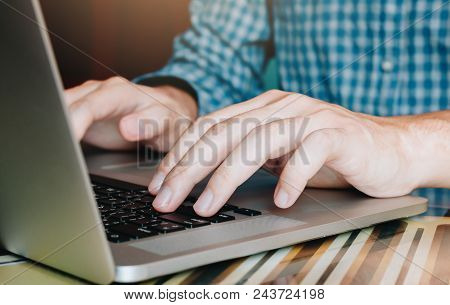 Close Up Woman Hand Using Laptop And Typing Button Keyboard.
