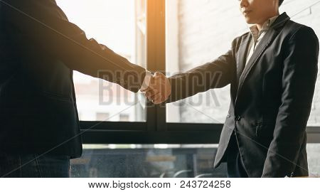 Business People Standing And Shaking Hand At Boardroom.