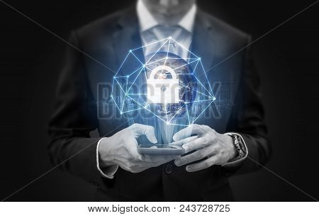 Network Data Security System Technology. Businessman Using Mobile Phone And Global Network Technolog