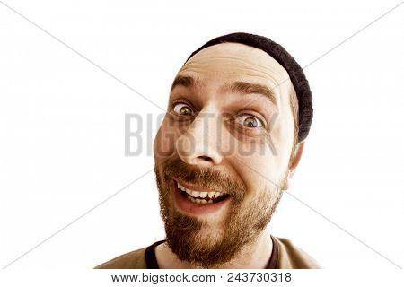 Funny face closeup of joyful weird man isolated on white