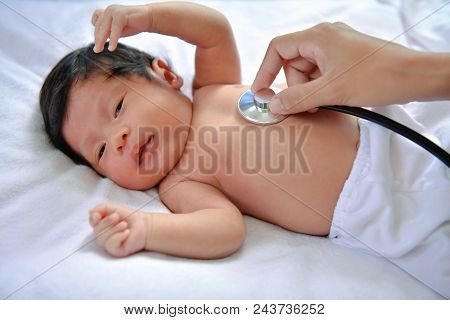 Baby Sick Concept. The Doctor Is Examining The Baby's Illness.