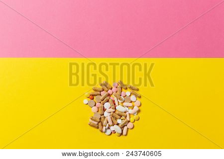 Medication White Colorful Round Tablets Arranged Abstract On Yellow Pink Color Background. Aspirin C