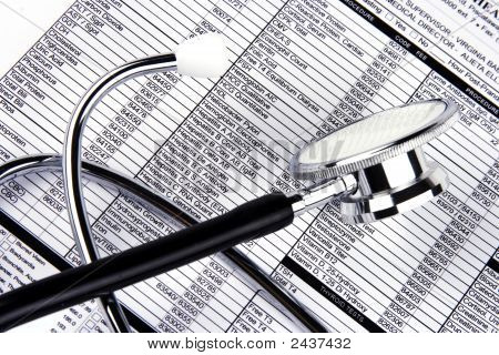 Stethoscope Over A Report