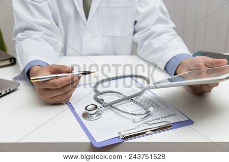 Healthcare And Medical Concept, Doctor Using Tablet And Working In Office.