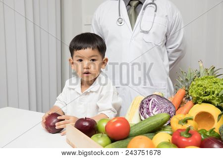 Healthy And Nutrition Concept. Kid Learning About Nutrition With Doctor To Choose How To Eat Fresh F