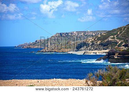 View Along The Rugged Coastline Towards Marsalforn, Redoubt, Marsalforn, Gozo, Malta, Europe.