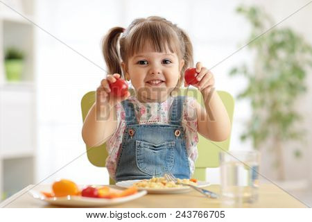 Healthy Kids Nutrition Concept. Cute Toddler Girl Sitting At Table With Plate Of Salad, Vegetables,