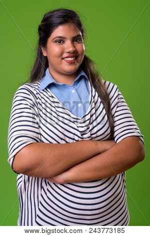 Studio Shot Of Young Overweight Beautiful Indian Businesswoman Against Chroma Key With Green Backgro