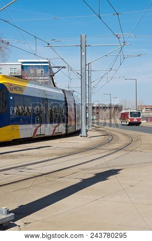 Mpls, Mn/usa - April 22, 2018: Light Rail Commuter Train And University Of Minnesota Shuttle Bus Alo