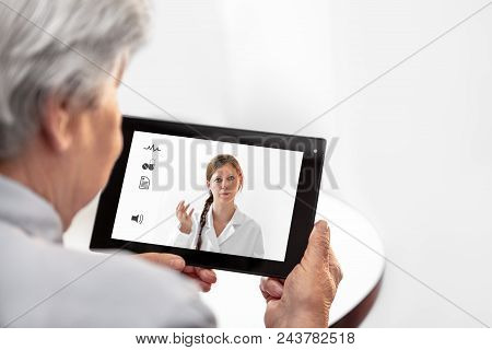 Telemedicine Or Telehealth With A Doctor And A Senior Woman With Tablet, Copyspace