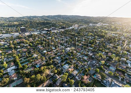 Late afternoon aerial view of Sherman Oaks and Encino in the San Fernando Valley area of Los Angeles, California.