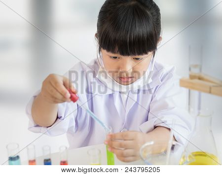 Asian Girl Doing Laboratory Test, Science Classroom