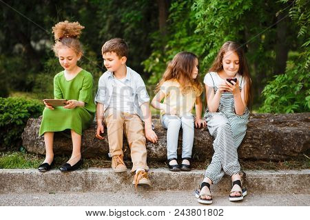 Primary Education, Friendship, Childhood, Technology And People Concept - Group Of Happy Elementary