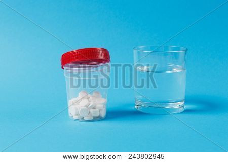 Medication Jar With White Round Tablets Arranged Abstract On Blue Color Background. Aspirin, Glass W