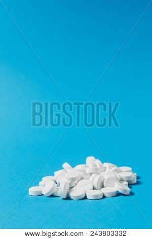 Medication Pile White Round Tablets Arranged Abstract On Blue Color Background. Aspirin, Capsule Pil