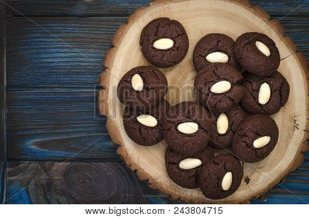 Chocolate Cookies With Raspberry Jam And Almonds